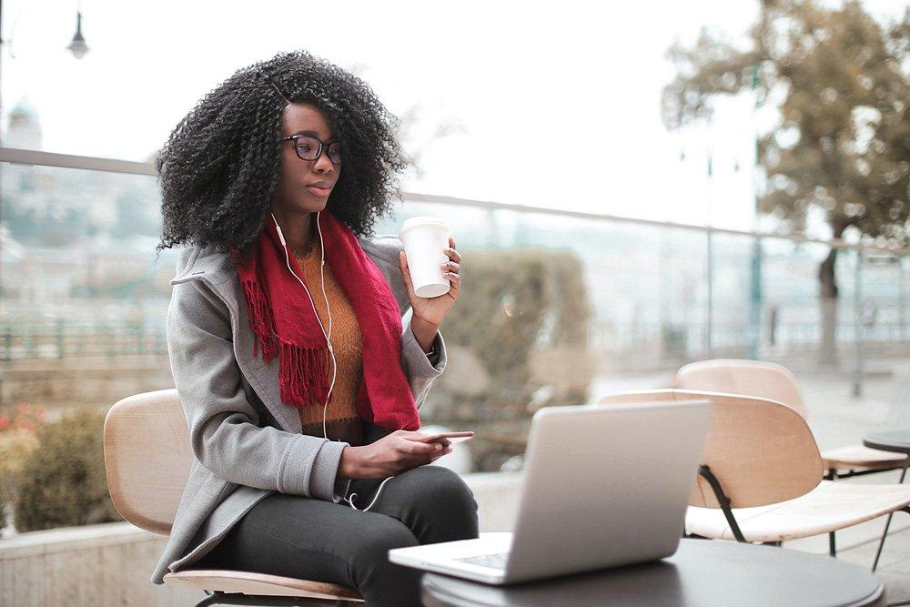 Woman using all senses on laptop